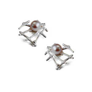 Asymmetric silver studs with blush pearls by Katerina Damilos