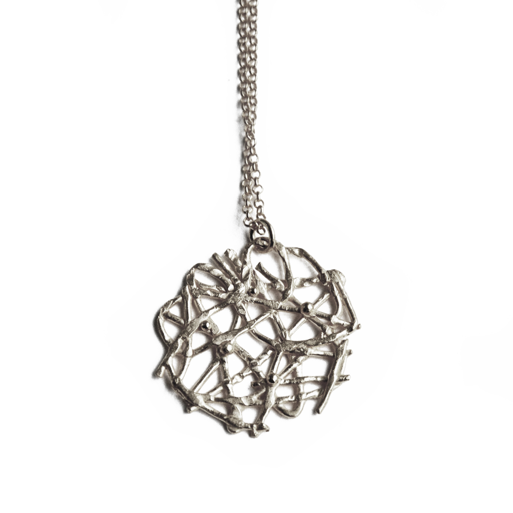 Asymmetric lace pendant in sterling silver by Katerina Damilos