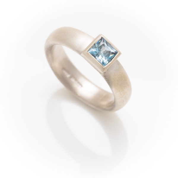 Silver ring with square topaz