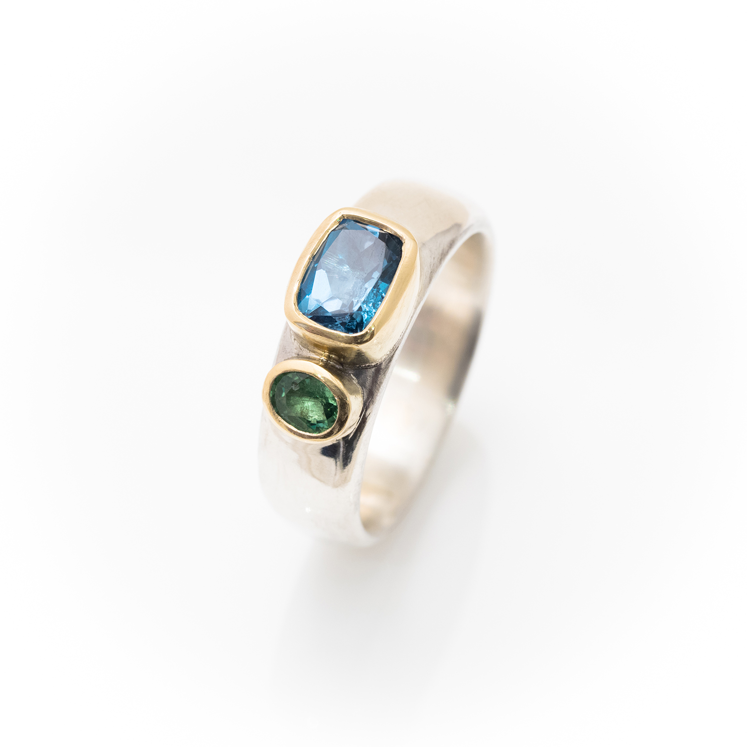 Wide silver ring with Topaz and tsavorite garnet