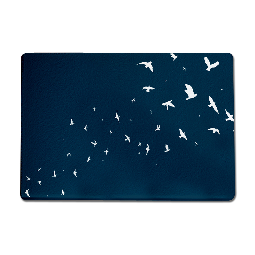 This extra large glass chopping board features a textured, hard-wearing and heatproof surface, along with anti-slip rubber feet.  Featuring my hand drawn Flock of Birds illustration in blue and white, this worktop saver adds a splash of colour to any kitchen. It can be used as a hard wearing chopping board, hygienic butchers block, colourful serving platter, cheese board or trivet heat mat and is made to the highest quality in the UK. I recommend wipe cleaning only to keep the mat in the best condition. 400mm x 285mm.