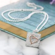 Sterling silver and rose gold neon art heart necklace