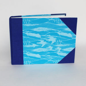 A6 landscape format sketch book with 'Hills and Dales' cover in blue and white