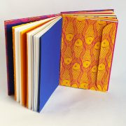 Memory book with fish design covers showing envelope