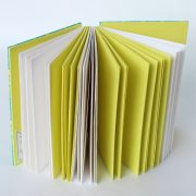 'fish design' open spine hand stitched journal with yellow and white pages
