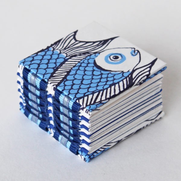 Mini fish open spine book in blue and white
