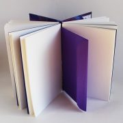 Pages and envelope of purple peacock memory book