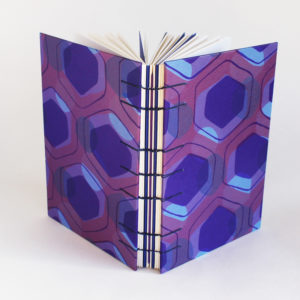 Spine and covers of of peacock purple memory