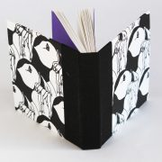 Pocket puffin sketch book showing both covers and purple endpapers
