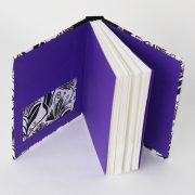 Travellers Joy pocket sketchbook showing purple endpapers and pocket