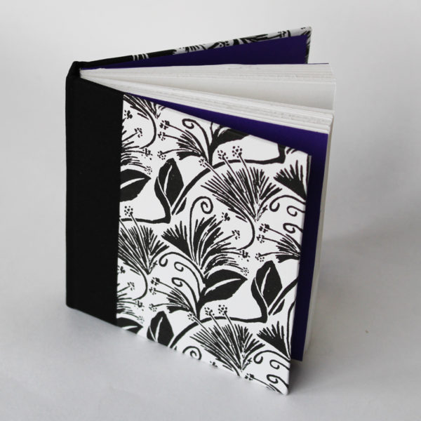 Travellers Joy pocket sketchbook with black backcloth spine and purple endpapers