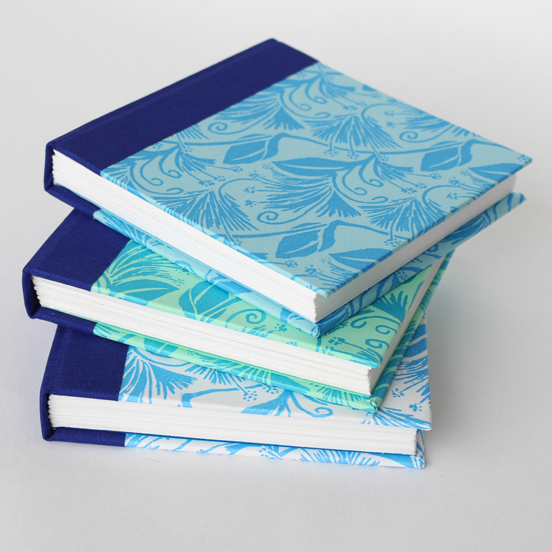Pile of small square notebooks