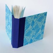 Front of square notebook in blues