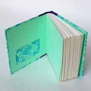 small square notebook in pastel green with pocket