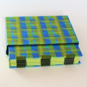 green zigzap open spine book with matching slipcase