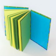 green zigzap open spine book with coloured pages