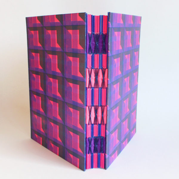 pink and purple open spine book
