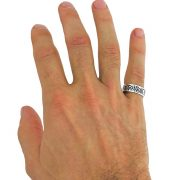 hand wearing silver ring band