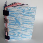 blue and white open spine artists notebook