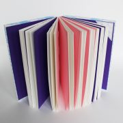 blue and white open spine notebook