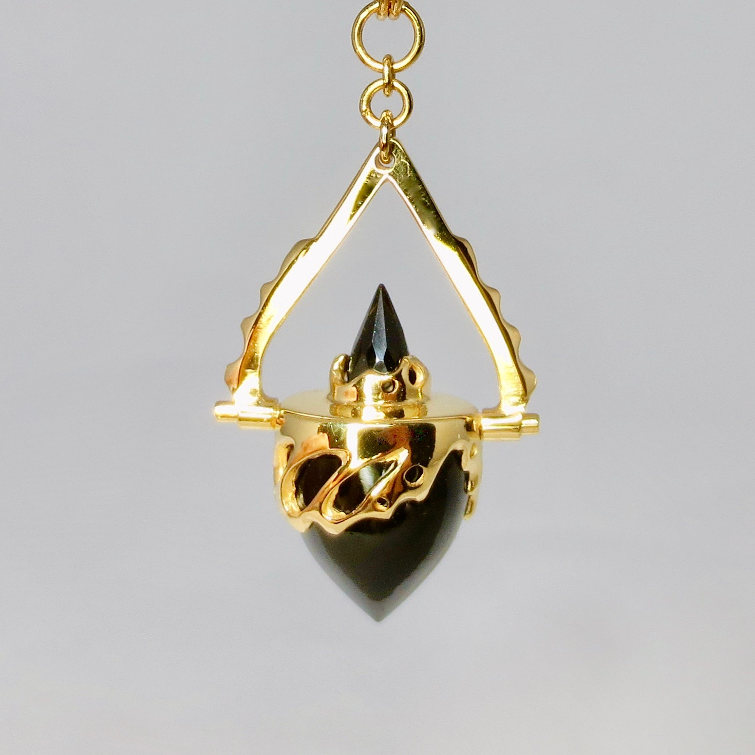 black onyx and gold pendant