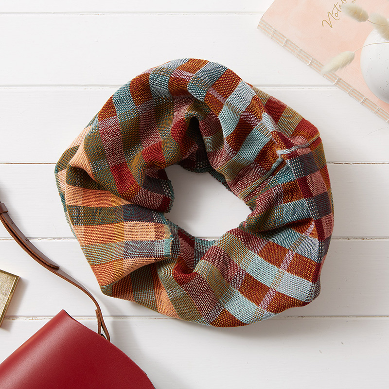 By Cecil Handwoven Cotton Snood in thick stripes of burgundy, mint, teal, ochre