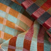 Detail of By Cecil handwoven cotton snood with thick stripes of burgundy, mint, teal, ochre