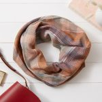 By Cecil handwoven cotton snood in stripes of rust, burgundy, pale blue and deep orange