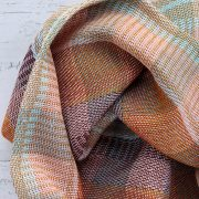 Detail of By Cecil handwoven cotton snood in stripes of ochre, burgundy, pale blue