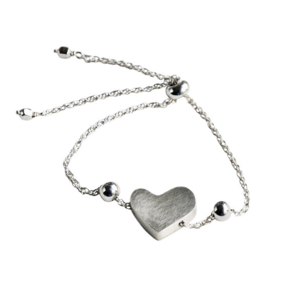 Adjustable silver bracelet with a heart charm