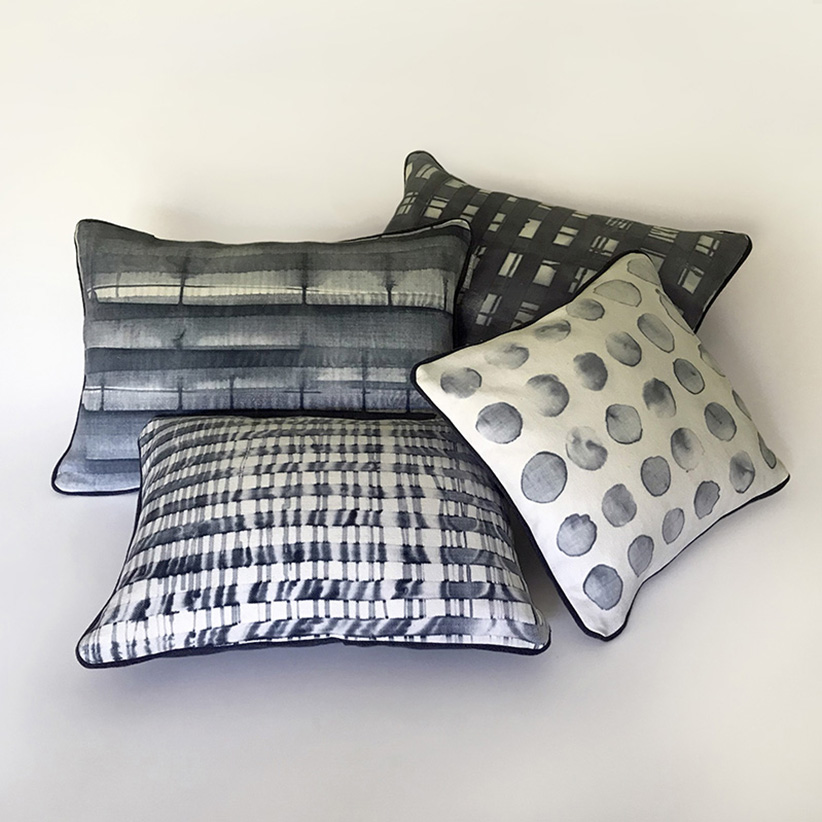 Monoprinted group of four complementing cushions