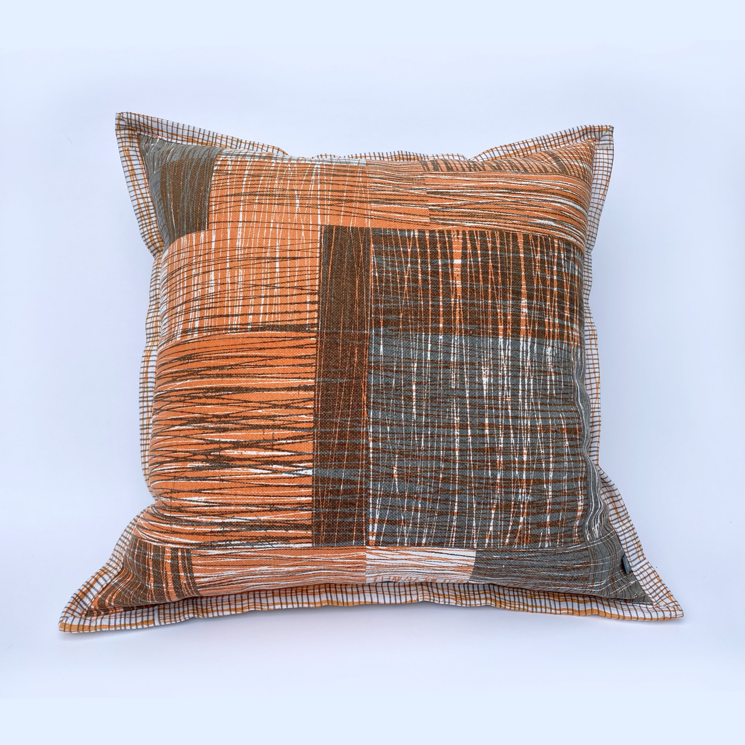 Handprinted cushion featuring original  'Scratch' design with complementary border.