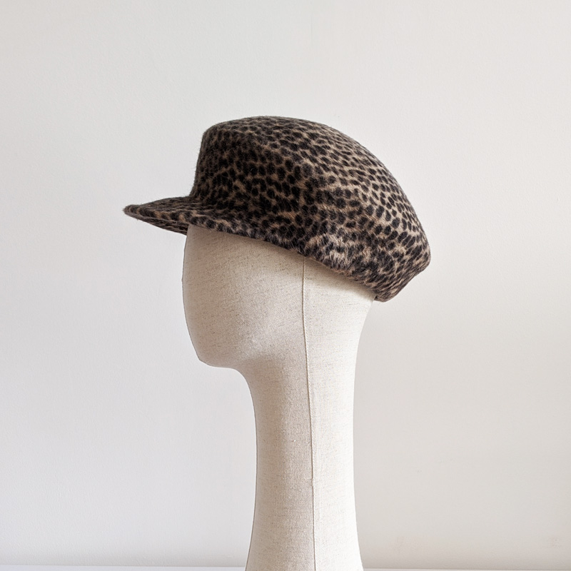cap on hat stand
