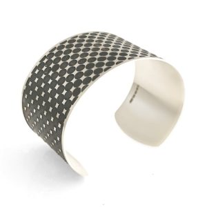 silver cuff with optical effect sideview on a white background