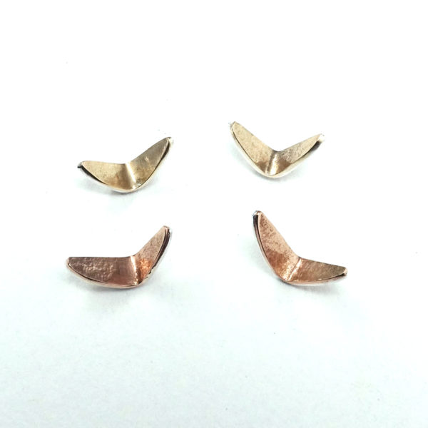 A Murmuring flock studs in silver and gold