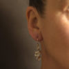 Drop silver earrings in a wave of silver by Cornwall designer Emily Nixon