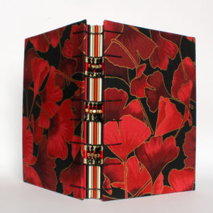 red gingko book with beaded spine