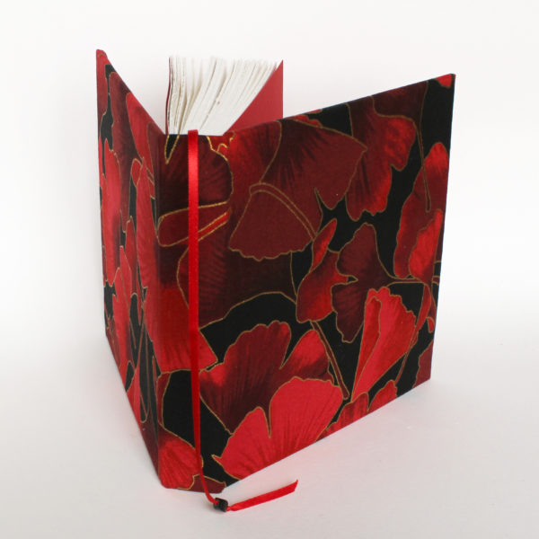 red ginkgo square sketch book with place marker