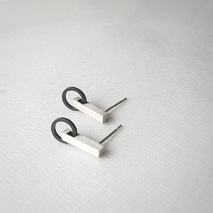 Artisan Minimalist Patina Stud Earrings in Sterling Silver is shown on the white surface.