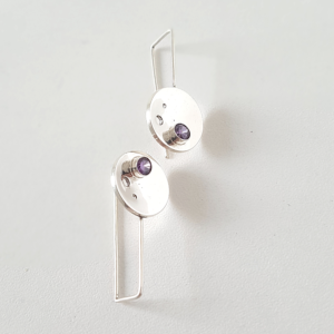 Handmade Silver CZ Circle Drop Earrings are placed on the white surface.