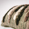 Texture detail of the handwoven 'Caterpillar' cushion featuring Merino wool by Cassandra Sabo