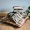 Stack of handwoven cushions from the Forest collection featuring Merino and blue-faced Leicester wools by Cassandra Sabo