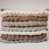 Cassandra Sabo's handwoven wool, rectangular 'Double Tendril' cushion from her Forest Collection