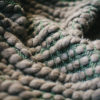 Texture detail of the handwoven 'Burrows' throw featuring blue-faced leicester wool by Cassandra Sabo