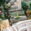 Handwoven 'Caterpillar' throw featuring Merino wool by Cassandra Sabo wrapped under the Christmas tree
