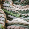Close-up texture detail of the Handwoven 'Caterpillar' throw featuring Merino wool by Cassandra Sabo