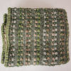 Reverse side of the handwoven 'Double Tendril' throw featuring Merino wool by Cassandra Sabo