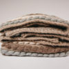 Blanket stitch detail of the handwoven 'Tendril' throw featuring blue-faced leicester wool by Cassandra Sabo