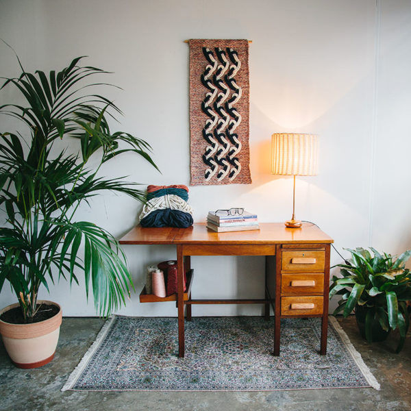 Cassandra Sabo's 'Elude' handwoven textile wall-hanging from her West Coast Collection hung on the wall above a desk