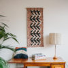Cassandra Sabo's 'Elude' handwoven textile wall-hanging from her West Coast Collection hung on the wall above a desk featuring cotton macrame cord.